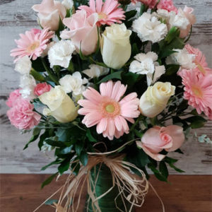 vase soft pink and white flowers raffia bow