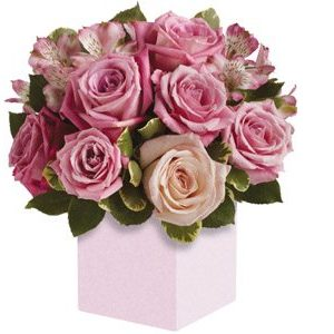 A dainty arrangement of Roses and Alstromeria in shades of light and creamy pinks.
