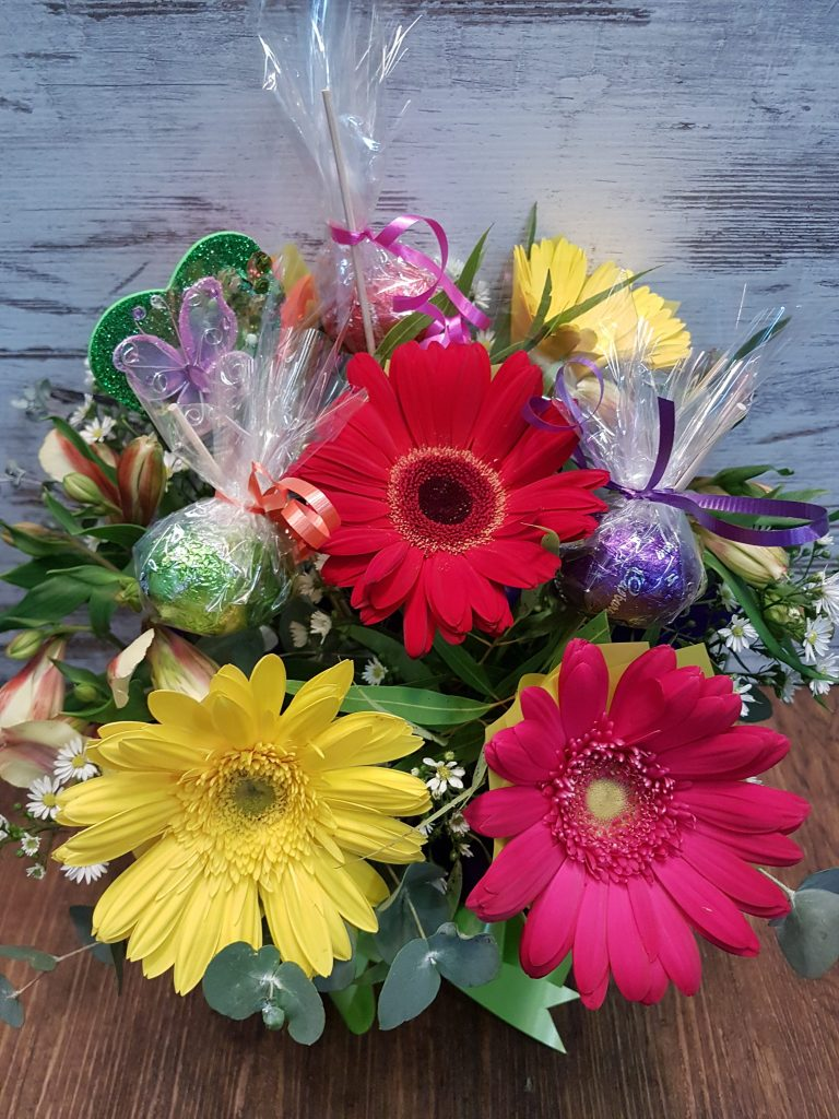 Easter gift flowers and chocolate eggs