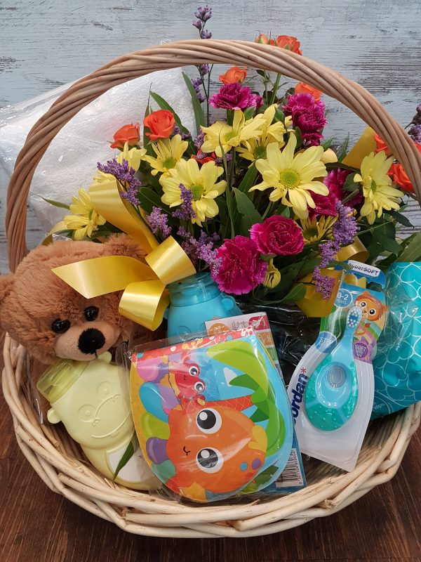 Gift basket of flowers and baby products