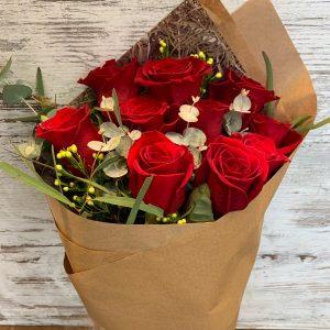 ten red roses natural wrap