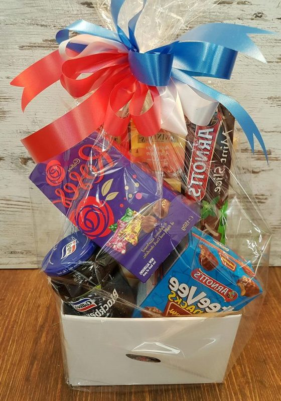 Sweet treat gift hamper are jams, biscuits, chocolate, teas, coffee and wine.